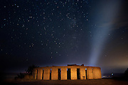 Urban light pollution from the city of The Dalles floods the night sky above Stonehenge at Maryhill, Washington. Nikon D700, 28/2 Ai.