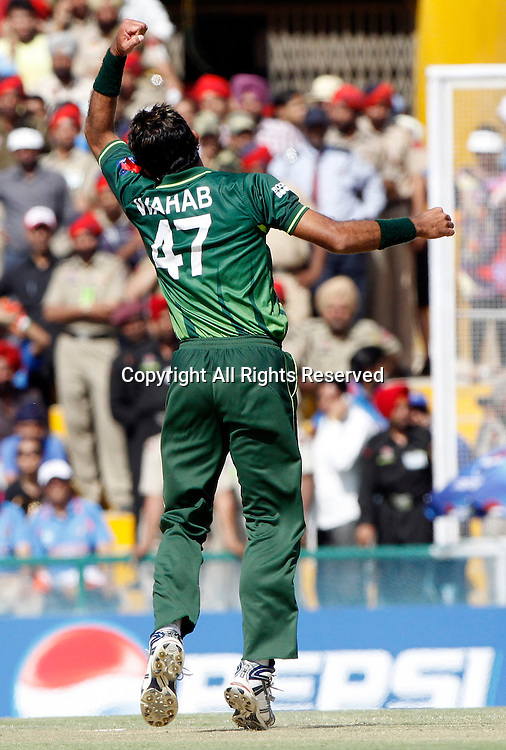 30.03.2011 Cricket World Cup from the Punjab Cricket Association Stadium, Mohali in Chandigarh. India v Pakistan. Wahab Riaz of Pakistan celebrates the wicket of Virender Sehwag during the match of the ICC Cricket World Cup between India and Pakistan.