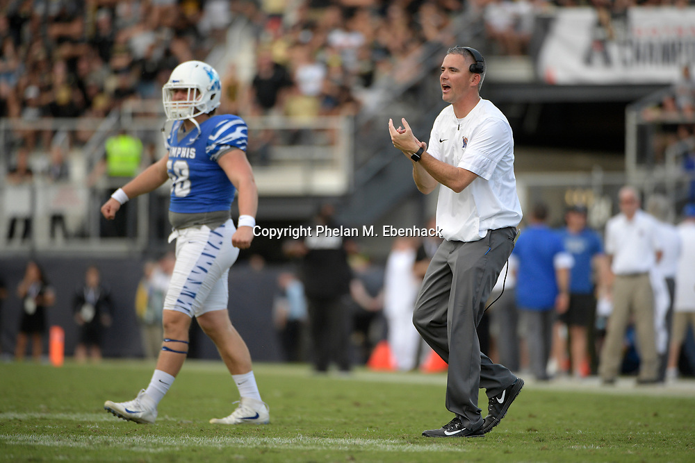 Memphis head coach Mike Norvell, right, applauds after a score during the second half of the American Athletic Conference championship NCAA college football game against Central Florida Saturday, Dec. 2, 2017, in Orlando, Fla. Central Florida won 62-55. (Photo by Phelan M. Ebenhack)