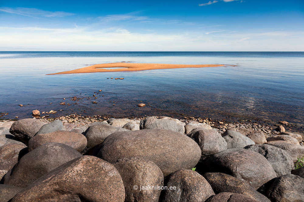 Lake Peipsi at Kallaste, Estonia. Water, sand with horizon. Stones on beach. Sand ridge.