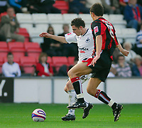 Photo: Leigh Quinnell.<br /> Bournemouth v Swansea City. Coca Cola League 1. 14/10/2007. Swanseas Paul Anderton looks for a way past Bournemouths Jason Pearce.