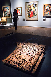 © Licensed to London News Pictures. 31/01/2018. London, UK.  A museum staff member views a fragment of an overdoor from the first-class lounge on the Titanic ship (1911) is on display as part of the Ocean Liners: Speed And Style exhibition at the V & A museum. The exhibits will re-imagine the golden age of ocean travel, exploring the design and cultural impact of the ocean liner on an international scale. Photo credit: Ray Tang/LNP