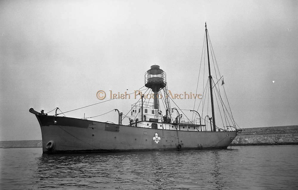 "Sea Scouts aboard the Lightship ""Albatross""..1972..22.07.1972..07.22.1972..22nd July 1972..Pictured berthed in Dun Laoghaire Harbour is the Lightship ""Albatross""..The ""Albatross was built by H.Robb,Leith,Scotland for the Commissioners of Irish Lights,Dublin. In 1970 the ship ,at the end of its working life,was sold to the Sea Scouts of Ireland for use as a Cadet Training Ship. Emblazoned on the side of the ship is the Scout Logo."
