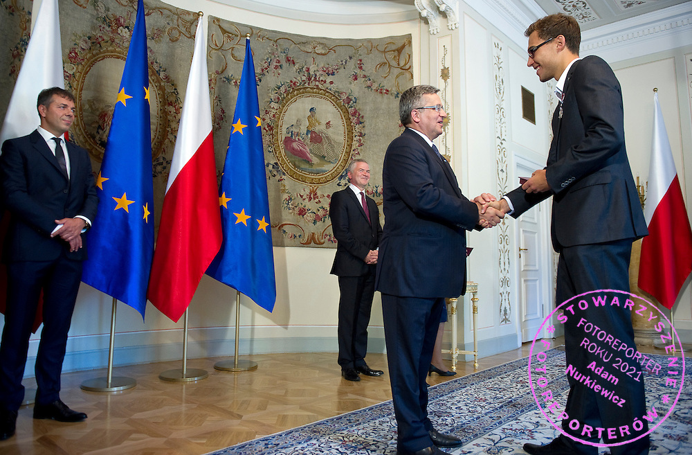 (R) Jerzy Janowicz and (C) Bronislaw Komorowski - President of Poland and (L) Krzysztof Suski - President of Polish Tennis Association during meeting in Belvedere Palace in Warsaw, Poland.<br /> <br /> Poland, Warsaw, July 08, 2013<br /> <br /> Picture also available in RAW (NEF) or TIFF format on special request.<br /> <br /> For editorial use only. Any commercial or promotional use requires permission.<br /> <br /> Photo by &copy; Adam Nurkiewicz / Mediasport