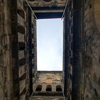 Inside the Porta Nigra - not just a simple gate, the massive structure was a key point in the walled city of Trier.  Those wishing to breach the gates first set of doors would look up to see this view -- likely a violent iron & hot-oil based welcome gift!