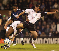 Fotball<br /> England 2004/2005<br /> Foto: SBI/Digitalsport<br /> NORWAY ONLY<br /> <br /> FA Barclays Premiership<br /> Fulham v Newcastle United<br /> 4th May, 2005<br /> <br /> Fulham's Tomasz Radzinski and Newcastle's Charles N'Zogbia battle for the ball.