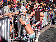16 SEPTEMBER 2012 - PHOENIX, AZ: Lucha Libre wrestlers tag team during a Lucha Libre exhibition match in Phoenix, AZ, on Hispanic Heritage Day. The Arizona Diamondbacks hosted their 14th Annual Hispanic Heritage Day, Sunday to kick off Hispanic Heritage Month (Sept. 15-Oct. 15) before the 1:10 p.m. game between the D-backs and San Francisco Giants. The main attraction of the Day was three Lucha Libre USA exhibition wrestling matches in front of Chase Field stadium before the game.  PHOTO BY JACK KURTZ