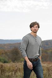 handsome man in a henley shirt outdoors