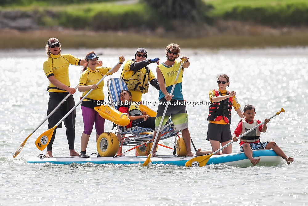 Thomas and his support crew go paddle boarding during the Flight Centre Halberg Disability Sport Foundation Raglan Surf Day on Sunday 20 March 2016.<br /> <br /> Copyright Photo: Bruce Lim / www.photosport.nz