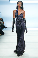 Leila Nda walks the runway wearing Cushnie et Ochs Fall 2016, hair by Antonio Corral Calero for Moroccanoil, makeup by Val Garland, photographed by Thomas Concordia during New York Fashion Week on February 12, 2016