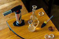 Dabbing live resin (Dabs are concentrated doses of cannabis that are made by extracting THC and other cannabinoids using a solvent like butane or carbon dioxide, resulting in sticky oils also commonly referred to as wax, shatter, budder, and butane hash oil (BHO). Live resin uses fresh, frozen whole cannabis flowers as opposed to buds that have been dried and cured. Aurora, Colorado USA.