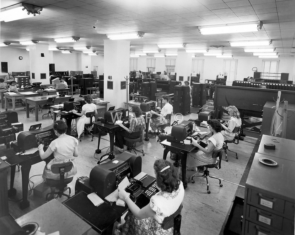 Women working at tabulating machines in Administrative Annex building.<br /> Date: 1953<br /> Stamped verso &quot;Credit Photo CF&amp;I Blast Pueblo, Colo.&quot;<br /> Prints Admin Pueblo Box 8