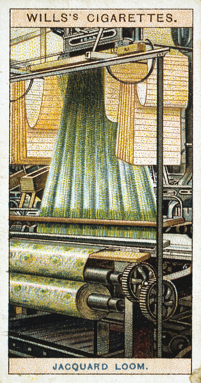 Jacquard power loom. In 1801 Joseph-Marie Jacquard (1752-1834) invented a method of weaving intricate patterns which were encoded on punched cards. The swags of punched cards carrying the pattern for this early 20th century power operated loom are clearly visible.