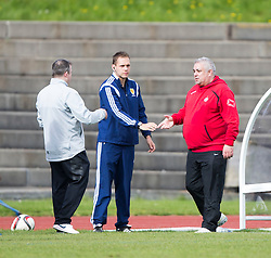 Edinburgh City's manager Gary Jardine and Brora Rangers manager David Kirkwood at the end. <br /> Edinburgh City 1 v 1 Brora Rangers, 1st leg, Pyramid Playoffs at Meadowbank, 25/4/2015.