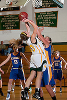 Bishop Brady's Victoria LeBlanc reaches up over Margaret Doheny for the shot during varsity basketball action with Kearsarge Monday evening.  (Karen Bobotas/for the Concord Monitor)