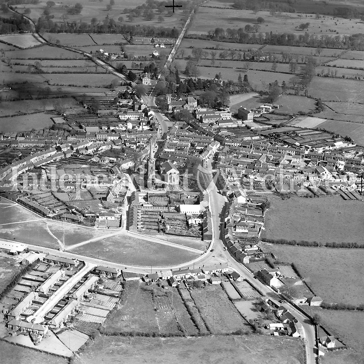 A104 Ceannas Mor (Kells).   16/10/54 (Part of the Independent Newspapers Ireland/NLI collection.)<br /> <br /> <br /> These aerial views of Ireland from the Morgan Collection were taken during the mid-1950's, comprising medium and low altitude black-and-white birds-eye views of places and events, many of which were commissioned by clients. From 1951 to 1958 a different aerial picture was published each Friday in the Irish Independent in a series called, 'Views from the Air'.<br /> The photographer was Alexander 'Monkey' Campbell Morgan (1919-1958). Born in London and part of the Royal Artillery Air Corps, on leaving the army he started Aerophotos in Ireland. He was killed when, on business, his plane crashed flying from Shannon.