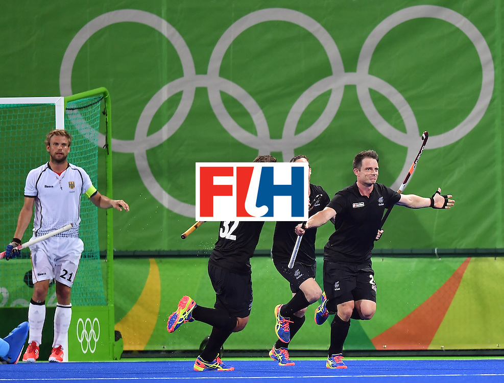 New Zealand's Shea McAleese (R) celebrates his team's second goal during the men's quarterfinal field hockey Germany vs New Zealand match of the Rio 2016 Olympics Games at the Olympic Hockey Centre in Rio de Janeiro on August 14, 2016. / AFP / MANAN VATSYAYANA        (Photo credit should read MANAN VATSYAYANA/AFP/Getty Images)