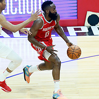 28 February 2018: Houston Rockets guard James Harden (13) drives past LA Clippers forward Wesley Johnson (33) during the Houston Rockets 105-92 victory over the LA Clippers, at the Staples Center, Los Angeles, California, USA.