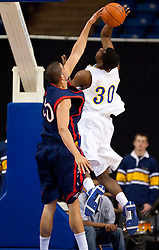 November 30, 2009; San Jose, CA, USA;  Saint Mary's Gaels center Omar Samhan (50) blocks a shot by San Jose State Spartans center Chris Oakes (30) during the first half at the Event Center Arena.  Saint Mary's defeated San Jose State 78-71.