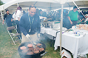 Donnie Brown of the College of Education cooks hamburgers for alumni Bobcat during the homecoming tailgate party at Tailgreat Park on Saturday, October 8, 2016.