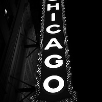 The Chicago Theater sign in black and white. The Chicago Theater is a Chicago Landmark and is listed with the National Register of Historic Places.