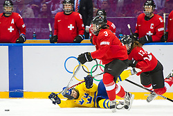 20.02.2014, Bolshoy Ice Dome, Adler, RUS, Sochi, 2014, Eishockey Damen, Spiel um die Bronzemedaille, im Bild Anna Borgqvist (SWE) gegen Sarah Forster (SUI), Sara Benz (SUI) // during Womens Icehockey Match for Bronze Medal of the Olympic Winter Games Sochi 2014 at the Bolshoy Ice Dome in Adler, Russia on 2014/02/20. EXPA Pictures © 2014, PhotoCredit: EXPA/ Freshfocus/ Urs Lindt<br /> <br /> *****ATTENTION - for AUT, SLO, CRO, SRB, BIH, MAZ only*****