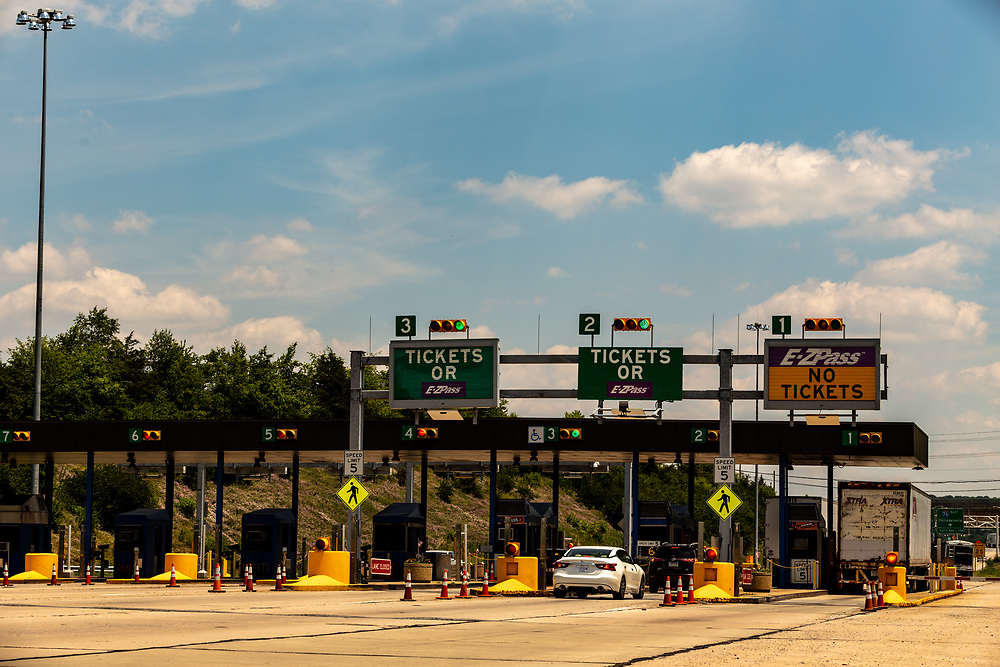 Denver, PA – June 20, 2016: Vehicles approach the entrance toll plaza at the Pennsylvania Turnpike Interchange.