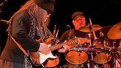 Papa Mali on Guitar with Bill Kreutzmann in background performing with 7 Walkers in Concert in The Wolfs Den at Mohegan Sun Casino on December 9, 2010