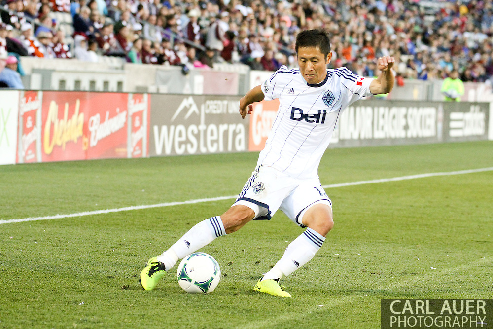 October 19th, 2013:  Vancouver Whitecaps FC forward/midfielder Kekuta Manneh (23) attempts a pass towards the goal in the second half of the MLS Soccer Match between the Vancouver Whitecaps FC and the Colorado Rapids at Dick's Sporting Goods Park in Commerce City, Colorado