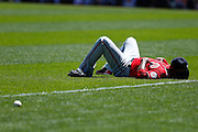 Denard Span #2 of the Washington Nationals relaxes in the outfield grass before the game against the Pittsburgh Pirates on May 5, 2013 at PNC Park in Pittsburgh, Pennsylvania. (Photo by Joe Robbins)
