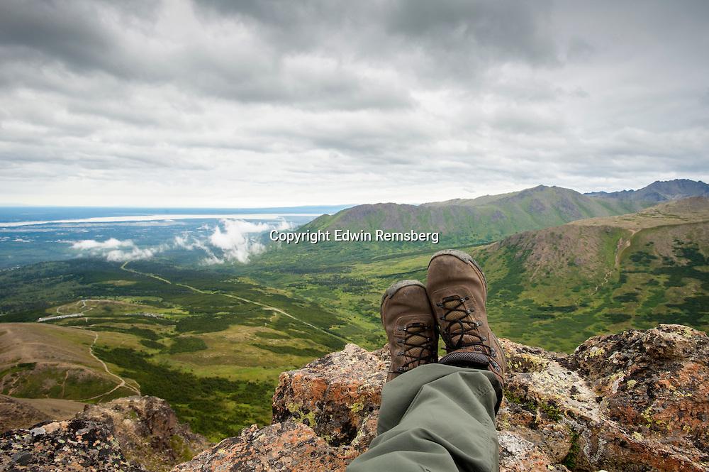 Climbers legs and feet on top of Flat Top Mountain trail, near Anchorage AK,  Chugach Mountains.