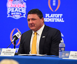 LSU Tigers head coach Ed Orgeron during the post game press conference after the Tigers defeated the Oklahoma Sooners in the 2019 College Football Playoff Semifinal at the Chick-fil-A Peach Bowl on Saturday, Dec. 28, in Atlanta. (Harrison McClary via Abell Images for the Chick-fil-A Peach Bowl)