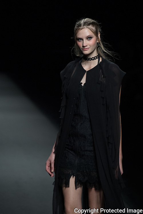 OCTOBER 21: A model  presents the Zin Kato collection at the Amazon Fashion Week Tokyo's 2017 Spring/Summer show under way at Shibuya Hikarie in Tokyo on Oct. 21, 2016. and other locations through 23rd. Dedicated in pursuing an exquisiteness unique to the Japanese, ZIN applies the most delicate of materials in order to compose the most elegant of apparels. ZIN excels in blending the wonders of surrealistic allure into our casual and accustomed wear. Nearly 50 fashion brands and companies will hold their shows at several locations through 23rd.. 21/10/2016-Tokyo, JAPAN