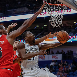 Oct 3, 2017; New Orleans, LA, USA; New Orleans Pelicans guard Jordan Crawford (27) shoots between Chicago Bulls guard Denzel Valentine (45) and forward Cristiano Felicio (6) during the second half of a NBA preseason game at the Smoothie King Center. The Bulls defeated the Pelicans 113-109. Mandatory Credit: Derick E. Hingle-USA TODAY Sports