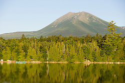 Mount Katahdin as seen in the early morning from Katahdin Lake in Maine's Baxter State Park.  Canoeing.