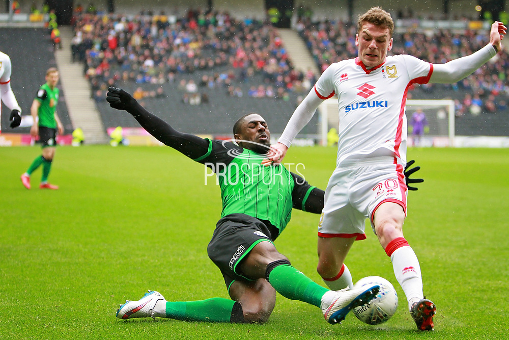 Scunthorpe United's Hakeeb Adelakun (16) and MK Dons Josh Tymon(20) during the EFL Sky Bet League 1 match between Milton Keynes Dons and Scunthorpe United at stadium:mk, Milton Keynes, England on 28 April 2018. Picture by Nigel Cole.