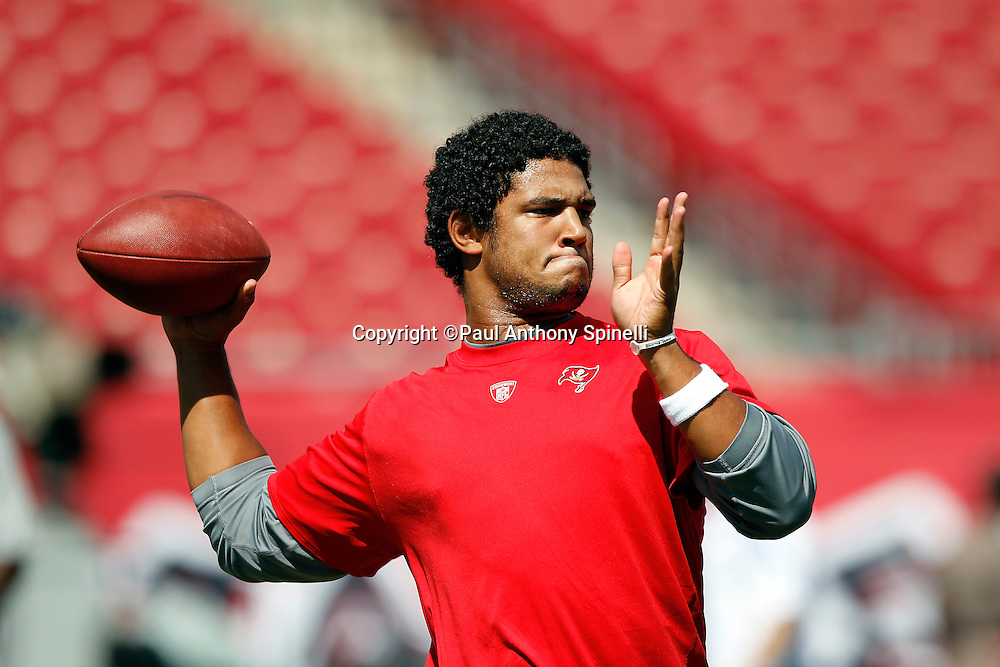 Tampa Bay Buccaneers quarterback Josh Freeman (5) throws a pregame pass in workout clothes during the NFL week 1 football game against the Detroit Lions on Sunday, September 11, 2011 in Tampa, Florida. The Lions won the game 27-20. ©Paul Anthony Spinelli