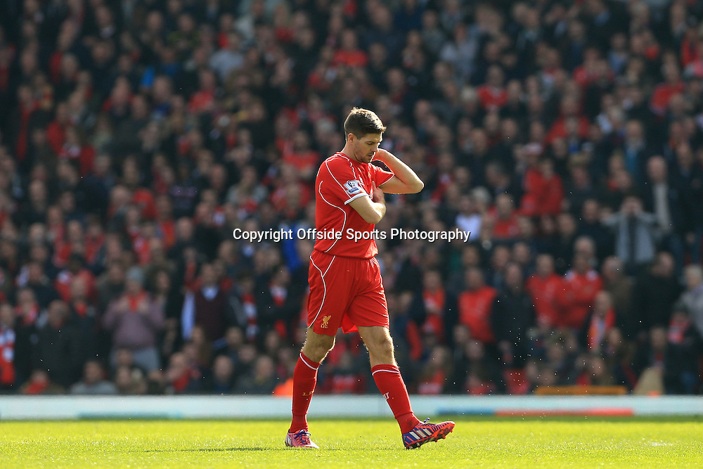 22nd March 2015 - Barclays Premier League - Liverpool v Manchester United - Steven Gerrard of Liverpool looks dejected as he walks off after being sent off - Photo: Simon Stacpoole / Offside.