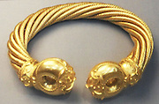 The Great Torc - Snettisham, buried around 100 BC.  This torc is one of the most elaborate golden objects from the ancient world.  It is made from gold mixed with silver and weighs over 1KG.