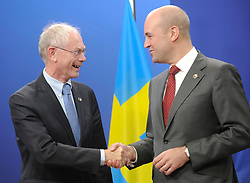Herman Van Rompuy, Belgium's prime minister, left, is greeted by Fredrik Reinfeldt, Sweden's prime minister and standing president of the European Council, as he arrives for the European Summit at the EU headquarters in Brussels, Belgium, on Thursday, Sept. 17, 2009. European Union leaders may call for sanctions on banks that pay excessive bonuses, fearing that runaway executive pay could trigger another financial crisis, a draft text showed. (Photo © Jock Fistick)