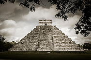 The east side of the Kukulkan Pyramid (El Castillo) at the Chichen Itza world heritage site, Yucatan, Mexico. The left side of the pyramid is unrestored and the right side is restored.