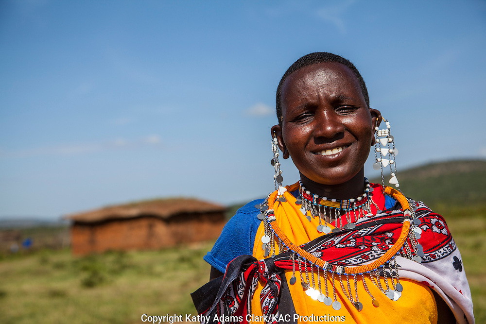Maasai women in native dress at a village outside, Serengeti National Park, Tanzania, Africa.