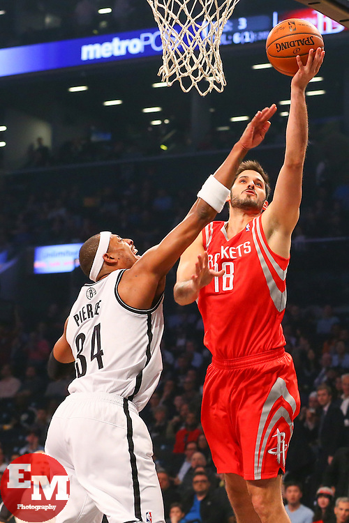 Apr 1, 2014; Brooklyn, NY, USA; Houston Rockets forward Omri Casspi (18) shoots the ball over Brooklyn Nets forward Paul Pierce (34) during the first quarter at Barclays Center.
