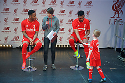 LIVERPOOL, ENGLAND - Friday, April 10, 2015: Liverpool's Raheem Sterling and Daniel Sturridge applaud a young supporter during the launch for the New Balance 2015/16 home kit at Anfield. (Pic by David Rawcliffe/Propaganda)