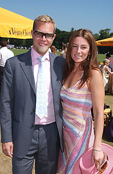 SEBASTIAN PEARSON and his wife AMANDA he is the son of Viscount Cowdray at the Veuve Clicquot sponsored Gold Cup Final or the British Open Polo Championship held at Cowdray Park, West Sussex on 17th July 2005.<br />