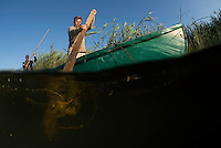 Paddling through Danube Delta fisherman, Christian Mititelu, Florin Moisa, Danube Delta, Romania