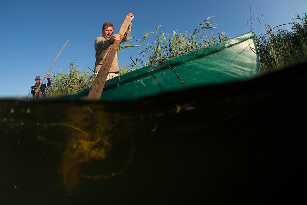 Paddling through Danube Delta fisherman, Christian Mititelu, Florin Moisa, Danube Delta, Romania