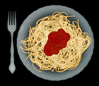 X-ray image of a pasta plate with fork (color on black) by Jim Wehtje, specialist in x-ray art and design images.