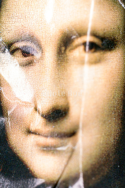 crumpled magazine page with the head of Mona Lisa