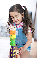 Girl playing with blocks at home